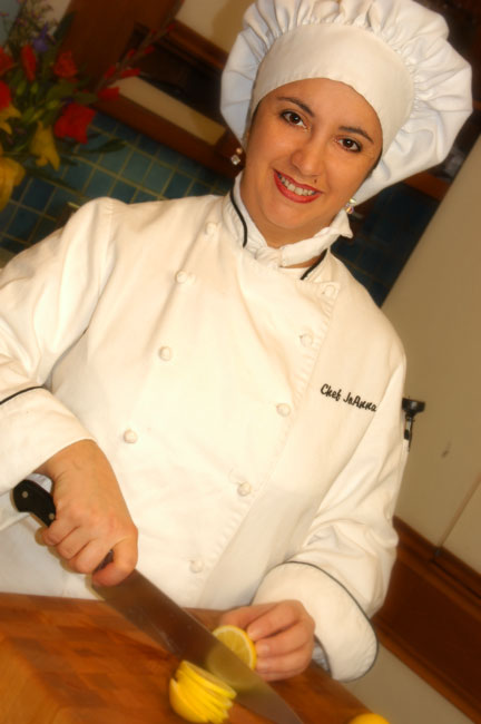Chef JoAnna, posed headshot, cutting a lemon